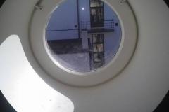 ümmargune katuseaken klaaspaketiga